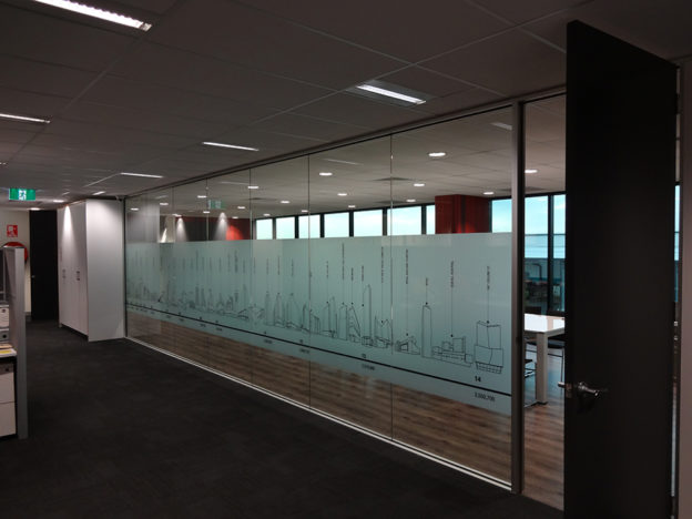 showing two rooms partitioned by a glass wall