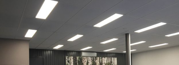 A office ceiling with bright lumena lights